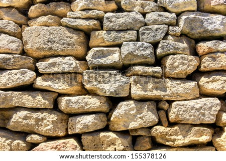 Stone wall in the south of France - stock photo