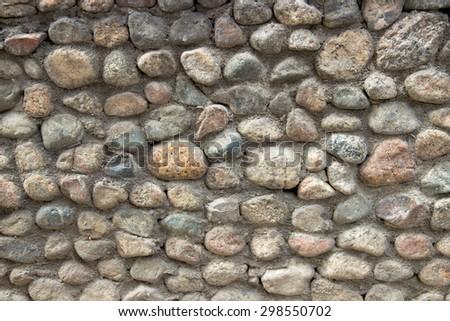 Stone wall made of random stone - stock photo