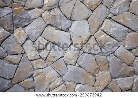 Stone Wall mixed in Orange and Grey Color - stock photo