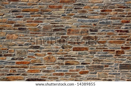 stone wall of a mediterranean town, background texture - stock photo