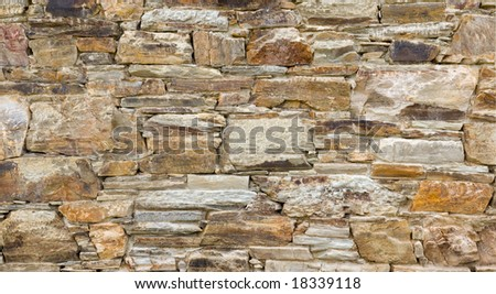Stone wall of an old house in Galicia, Spain. thickness of the wall is 70cm.