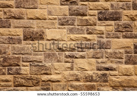Stone wall of natural stones .  Fragment of a Stone wall of natural stones