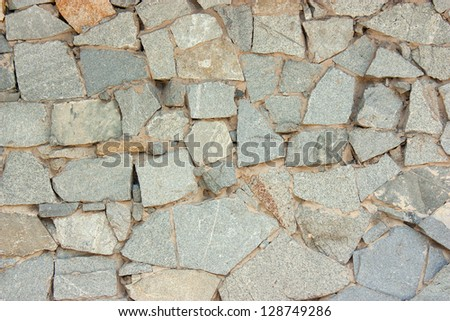 stone wall of the facade of the building, the background - stock photo