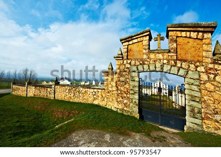 Stone Wall of the Old Catholic Cemetery in Spain - stock photo