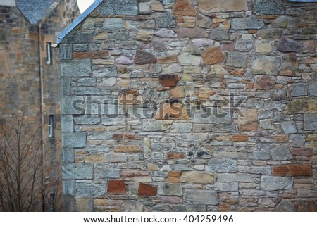 Stone wall, side of the old building - stock photo