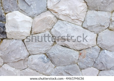 Stone wall texture and background - stacked stone Wall - stock photo