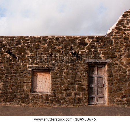 Stone wall with door and window in San Jose Mission, San Antonio, Texas - stock photo