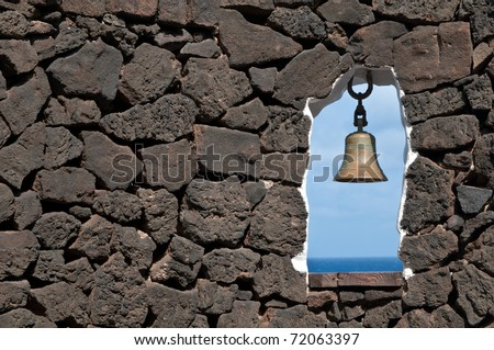 Stone wall with window to the sea, Spain - stock photo