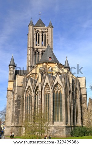 Stone walls with Gothic arches and towers of St Nicholas church in Ghent, Belgium - stock photo