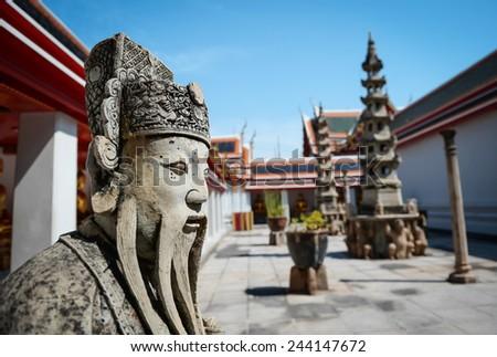 Stone warrior in Wat Pho in Bangkok, Thailand.  - stock photo