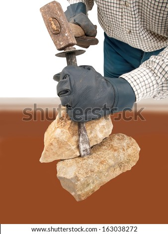 stone worker with hammer chisels stone  - stock photo