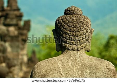 Stoned image of Buddha in Borobudur temple, Indonesia - stock photo