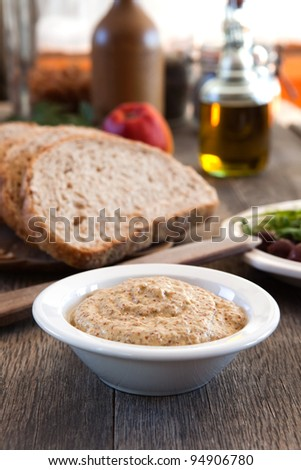 Stoneground mustard in a bowl - stock photo