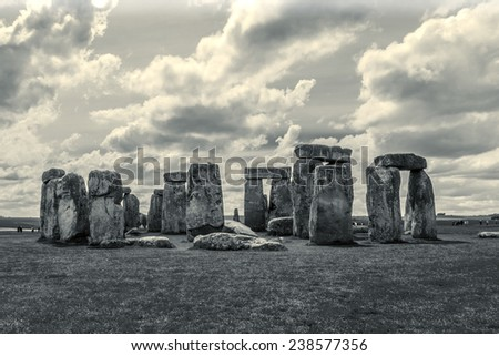 Stonehenge - an ancient prehistoric stone monument near Salisbury, Wiltshire, UK. It was built anywhere from 3000 BC to 2000 BC. Stonehenge is a UNESCO World Heritage Site in England. Vintage photo. - stock photo