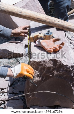 Stonemason at work - stock photo