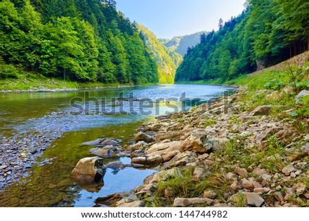 Stones and rocks in the beautiful morning in The Dunajec River Gorge - stock photo
