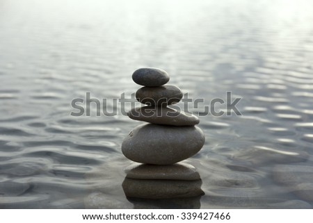 stones balanced on each other in the sea