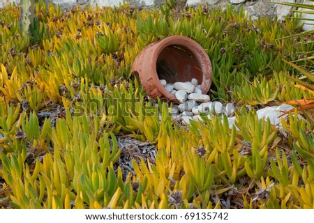 Stones flowing out of a pot on a Greek island - stock photo