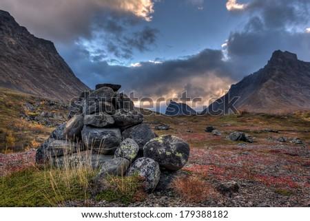 Stones in front of a dark sky in Lapland - Sweden - stock photo