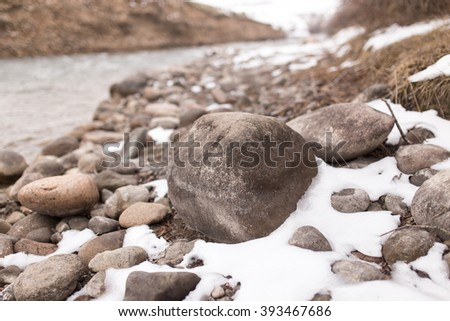 stones in the snow on the nature