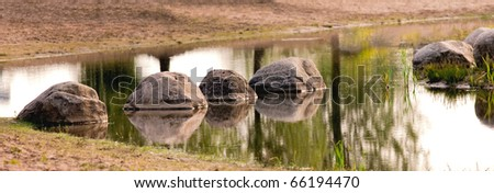 stones in the water - stock photo