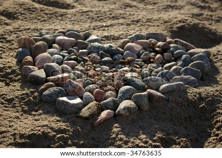 Stones layed in shape of heart - stock photo