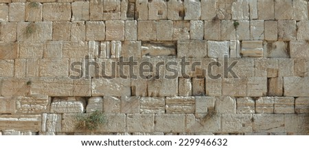 Stones of the wailing wall in Jerusalem with notes - stock photo