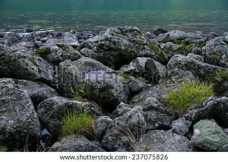 stones on a mountain lake in Altai - stock photo