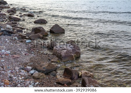 Stones on the bank of the river, summer evening