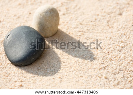 Stones on the sand in morning sunlight