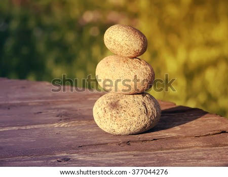 Stones on wooden table - stock photo