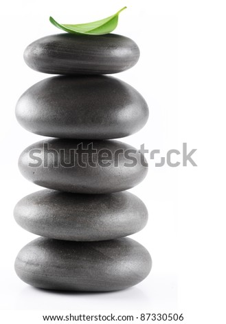 Stones spa with leaf isolated on a white background. - stock photo