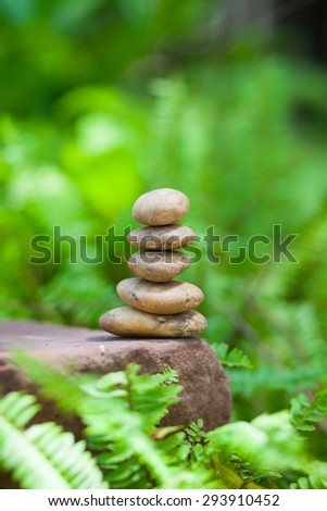 Stones stacked in the forest. - stock photo