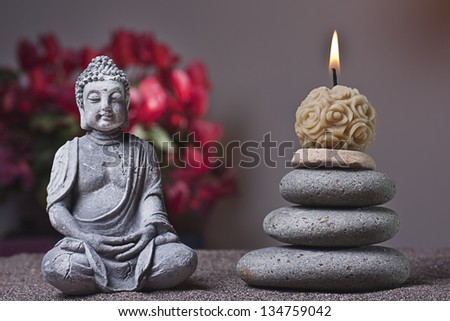 stones tower and candle, buddha - stock photo