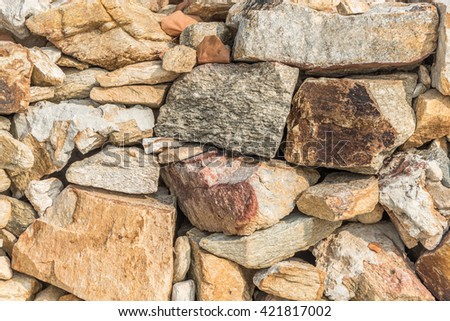 Stones wall for background or wallpaper.