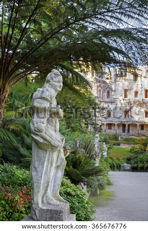 Stonestatue in the forest at Quinta da Regaleira, Sintra, Portugal
