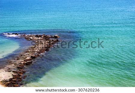Stony breakwater on the Black sea - stock photo