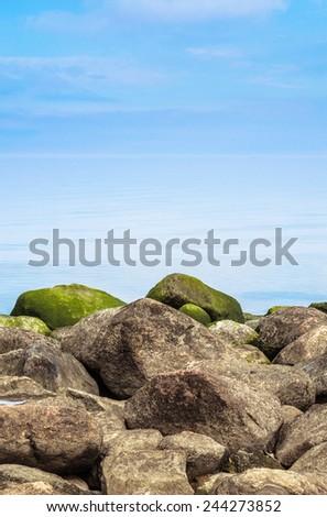 Stony coast of Baltic sea early in the morning - stock photo