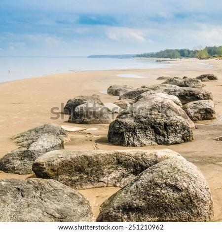 Stony on coast of Baltic sea early in the morning - stock photo