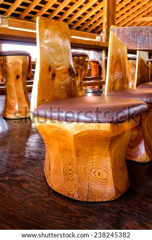 stool carved from a tree trunk in Canada - stock photo