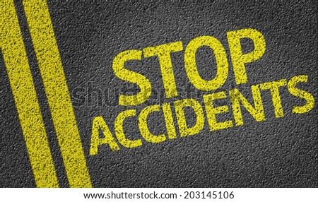 Stop Accidents written on the road - stock photo