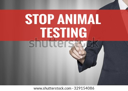 Stop Animal Testing word on virtual screen push by business woman red tab - stock photo
