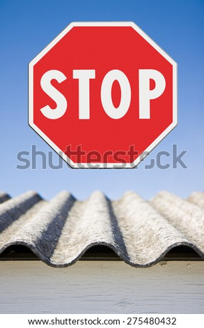 Stop asbestos concept. Stop Asbestos with road sign - stock photo