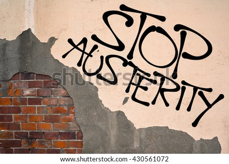 Stop Austerity - Handwritten graffiti sprayed on the wall, anarchist aesthetics. Protest against economical policy of reducing debt and and budget deficit by cuts and savings - stock photo