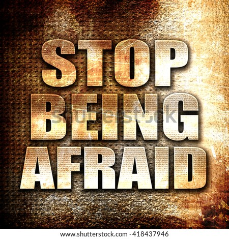 stop being afraid, rust writing on a grunge background - stock photo