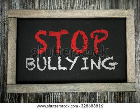 Stop Bullying written on chalkboard - stock photo