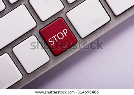 Stop button on white computer keyboard
