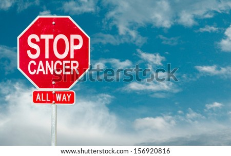 Stop Cancer creative sign on a sky background