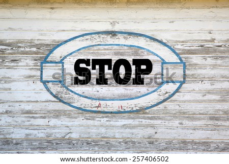 Stop Concept - Stop sign on shed side - stock photo