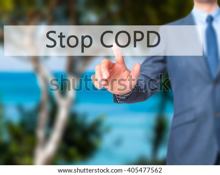 Stop COPD - Businessman hand pressing button on touch screen interface. Business, technology, internet concept. Stock Photo - stock photo
